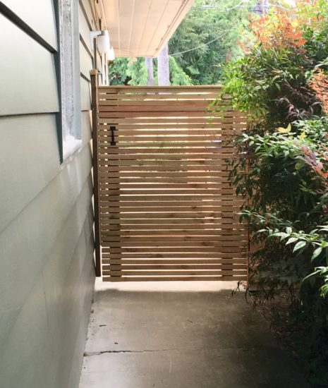 Gate with skinny boards on the horizontal
