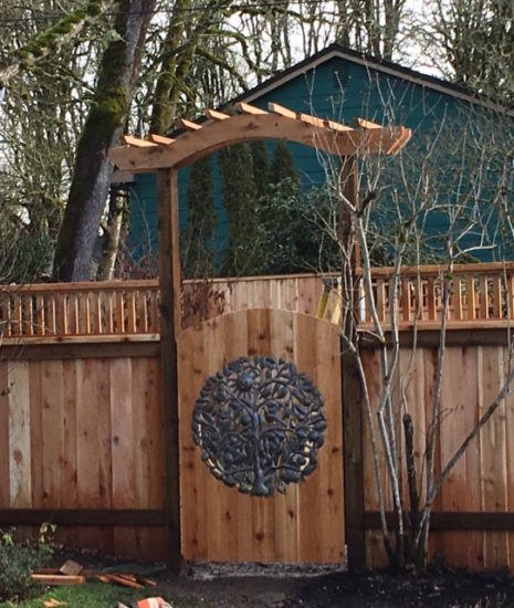 Custom gate with arbor and artwork