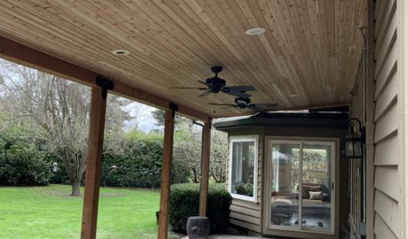 Patio cover with cedar tongue and groove ceiling, ceiling fans